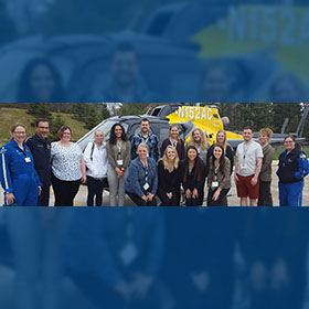 Northern Highland Area Health Education Center students pose with associates from Ascension Wisconsin Spirit Medical Transport and the Spirit 2 helicopter.