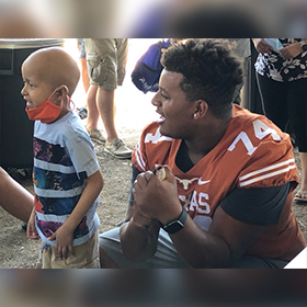 Texas Longhorn football players visit Dell Children's Medical Center of Central Texas in Austin, Ascension Texas.