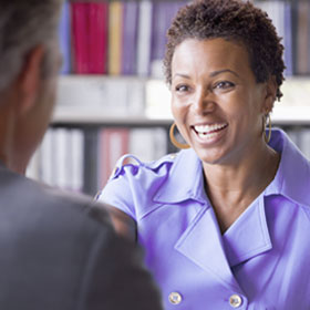 Smiling woman talking to man at Ascension Ministry Service Center